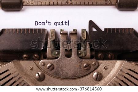 Vintage typewriter close-up - Don't Quit determination message - stock photo