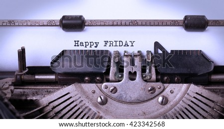 Vintage typewriter close-up - Happy friday, concept of motivation - stock photo