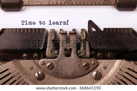 Vintage typewriter close-up - Time to learn, concept of learning - stock photo