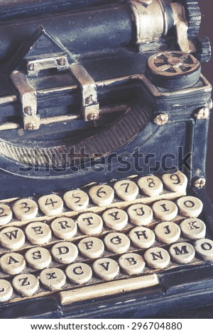 Vintage typewriter detail with stone carved keys photographed with shallow depth of field. Image cross processed for vintage look. - stock photo