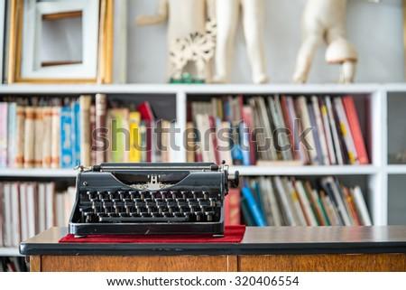 vintage typewriter in blur vintage room interior  - stock photo