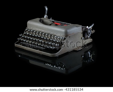 Vintage typewriter isolated on black background - stock photo