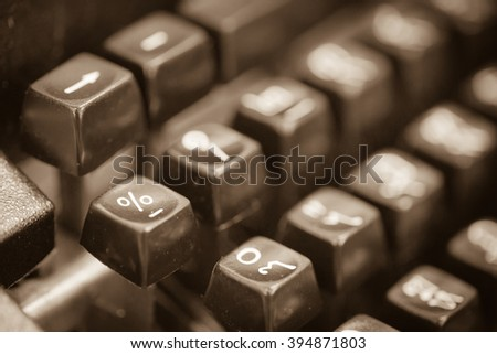 Vintage typewriter keyboard in sepia tone image