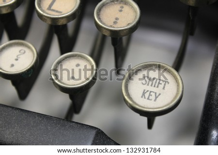 vintage typewriter keys with shift in focus - stock photo