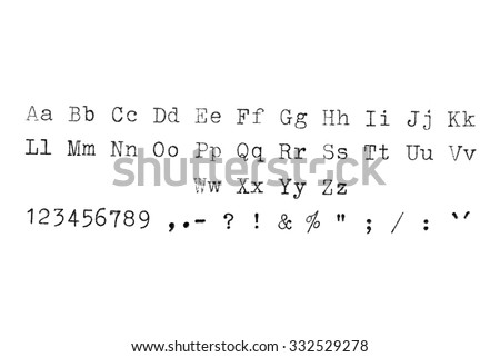 Vintage typewriter machine typeset alphabet, numbers and symbols on white paper. - stock photo