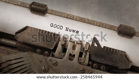 Vintage typewriter, old rusty and used, good news - stock photo