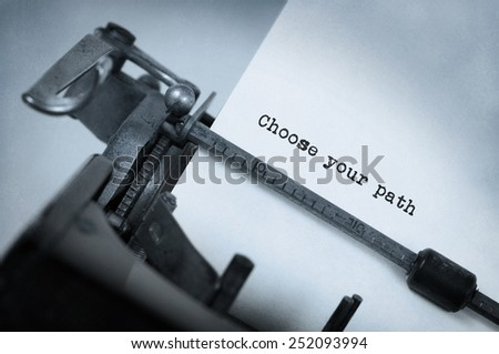 Vintage typewriter, old rusty, warm yellow filter, choose your path - stock photo