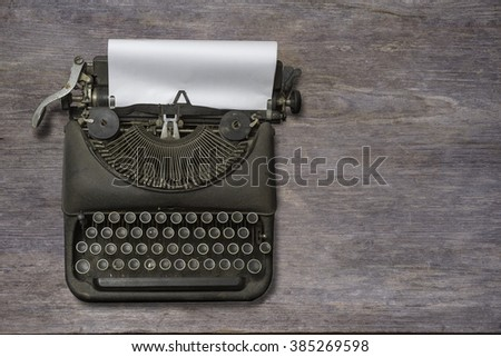 Vintage typewriter on wood background