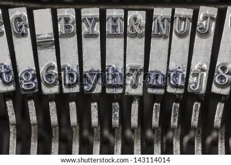 Vintage typewriter typebar hammers extreme macro. - stock photo