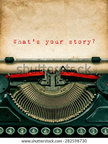 Vintage typewriter with aged textured grungy paper. Sample text What's your story? - stock photo