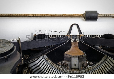 Vintage typewriter with ' P.S. i love you ' typed onto white paper with copy space.