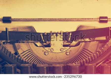 vintage typewriter with paper, retro film filtered, instagram style  - stock photo