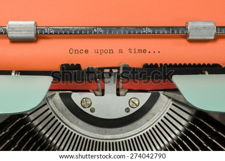 "Vintage Typewriter With Phrase ""Once upon a time..."" Typed in Orange Paper - stock photo"