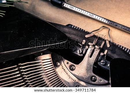 Vintage typewriter with shwwt of paper and printed 2016 digits. Closeup photography for blog and creative banners, or hero image. Symbol of blogging, writing, internet activity and creativity.