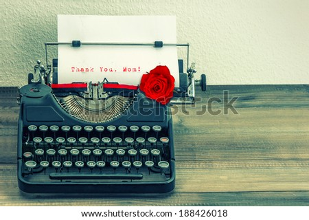 vintage typewriter with white page and red rose flower. sample text Thank You, Mom! Mother's Day concept. retro style toned picture - stock photo