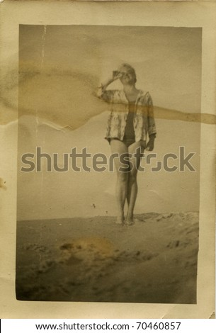 Vintage unretouched dirty photo of young woman (fifties) - stock photo