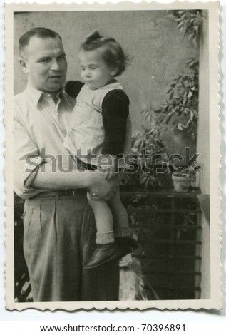 Vintage unretouched photo of father and daughter outdoor - stock photo