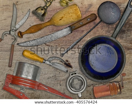 vintage utensils set for cooking over wooden table