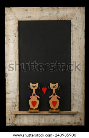 Vintage valentines love cats with red hearts chalkboard blackboard in reclaimed old wooden frame isolated on black with copy space