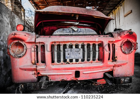 Vintage van abandoned on warehouse - stock photo