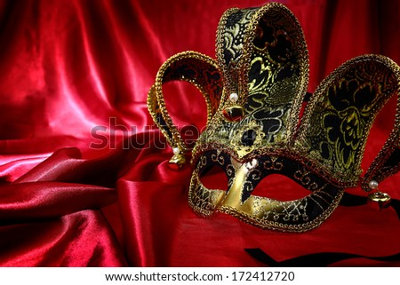 Vintage venetian carnival mask on velvet background - stock photo