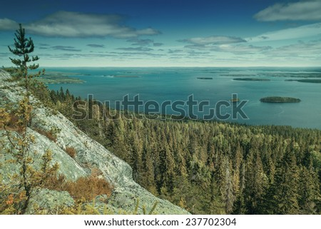 Vintage view from the top of the Koli national park to lake Pielinen - stock photo