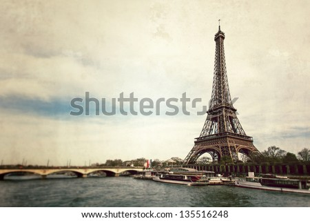 Vintage view of Eiffel tower from Seine river - Paris - France - stock photo