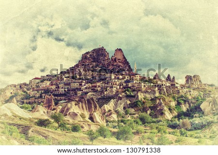 Vintage view of the Uchisar castle in Cappadocia, Turkey. Retro style photo. - stock photo