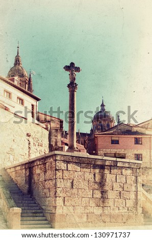 Vintage view to old big cross and Cathedral in Salamanca. Retro style photo.
