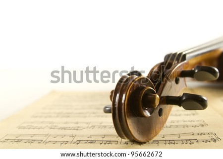 Vintage viola on sheet music background - stock photo