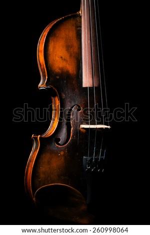 Vintage violin on black background - stock photo