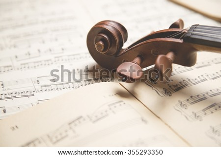 Vintage violin on the  sheet music. - stock photo