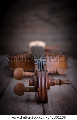 Vintage violin on wooden background