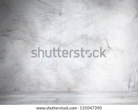 Vintage wall in industrial building with light from corner - stock photo
