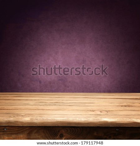 vintage wall of red and desk  - stock photo
