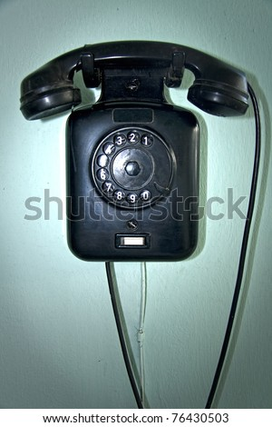 vintage wall telephone device from the sixties
