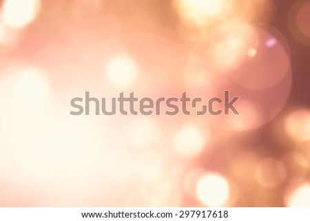 Vintage warm orange red brown color tone of blurred nature background of a view looking up through the foliage of a tree against the sky facing sun flare and bokeh   - stock photo