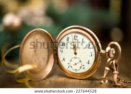 Vintage watch on a festive background showing five to twelve - stock photo