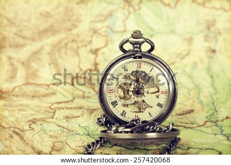 Vintage watch on antique map. Retro still life - stock photo