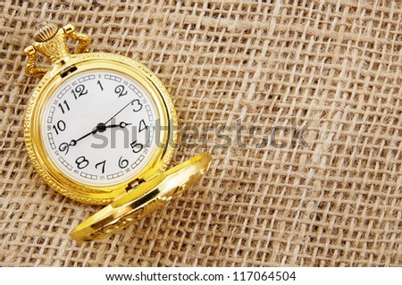 Vintage watch on hessian jute background - stock photo