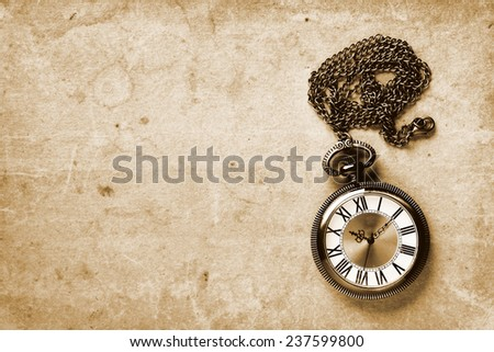 Vintage watch on old paper background - stock photo