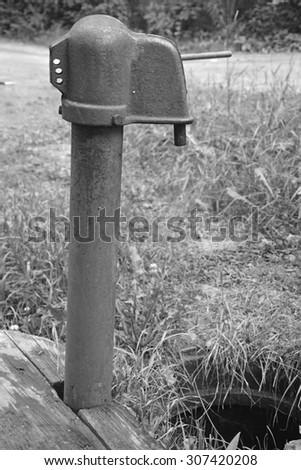 Vintage water-pump - stock photo