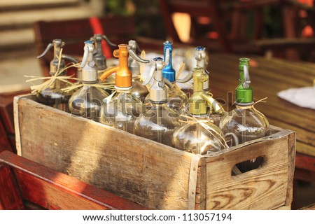 Vintage water siphons (seltzer bottles) in a wooden box. - stock photo