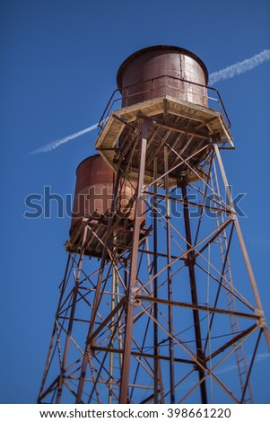 Vintage Water Towers with Blue Sky - stock photo