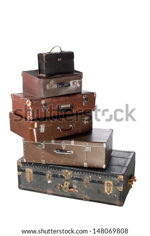 Vintage weathered leather suitcases on top of each other.separated background
