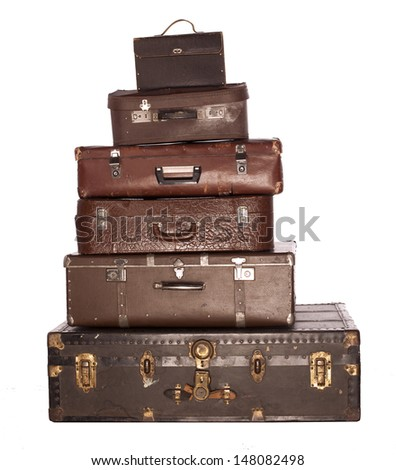 Vintage weathered leather suitcases on top of each other .separated white background - stock photo