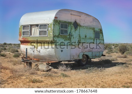 Vintage weathered Trailer in Desert - stock photo