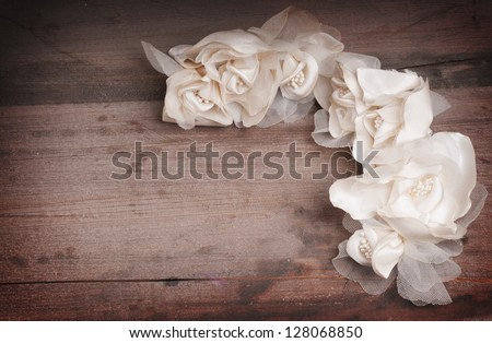 Vintage wedding dress flowers on a wooden backgroung