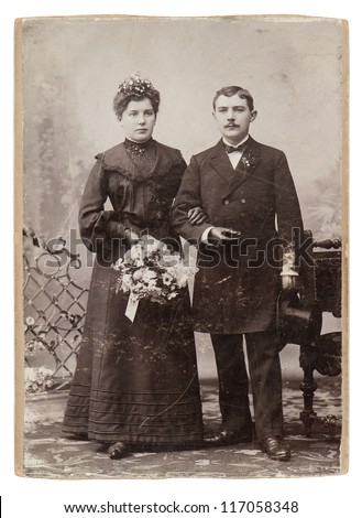 vintage wedding studio photo. just married couple circa 1900. nostalgic picture - stock photo