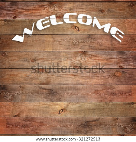 Vintage WELCOME sign on natural wooden surface. Closeup.